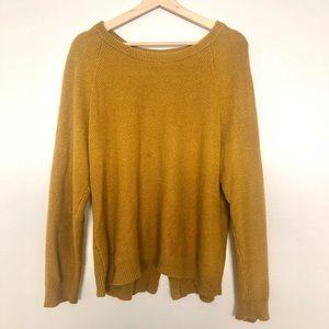 A knit  orange-yellow  sweater